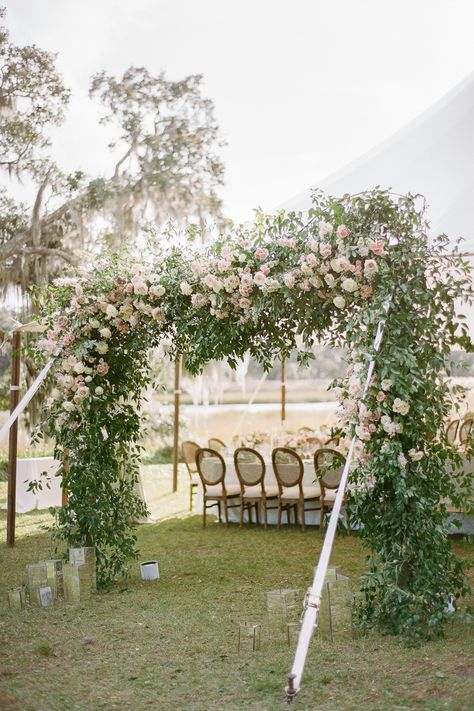 From the editorial Watercolor Paintings, Garden Style Florals, and a Natural Palette Inspired This Kiawah River Wedding. @thepetalreport and @petaloso left no detail unturned to bring the bride and groom's vision to life — just wait until you browse the full gallery! | Photography: @clayaustin #stylemepretty #weddingarch #flowerarch #weddingflowers #weddingflorals #floraldesign #weddingflowerideas