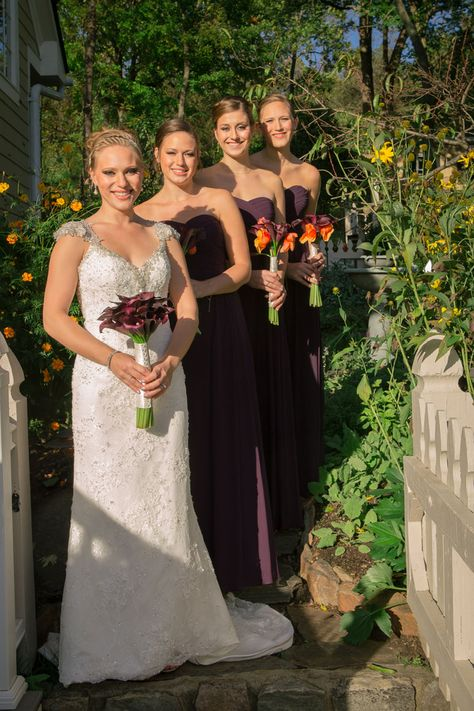 Bride and bridesmaids dressed in long purple dresses