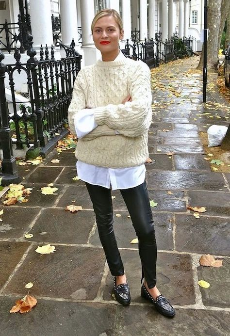 Pandora Sykes // red lips, cream cable knit sweater, white shirt, leather pants, and studded loafers