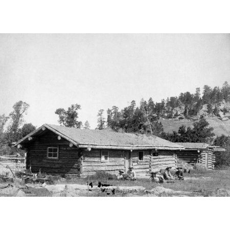 South Dakota Log Cabin Nfive Men Sitting In The Grass In Front Of An Old Log Cabin With A Thatched Roof In South Dakota Photogra Log Cabin Furniture Cabin Thatched Roof