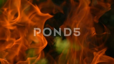 Fire against dark green natural blur background. Close up slow motion Stock Footage #AD ,#natural#blur#green#Fire