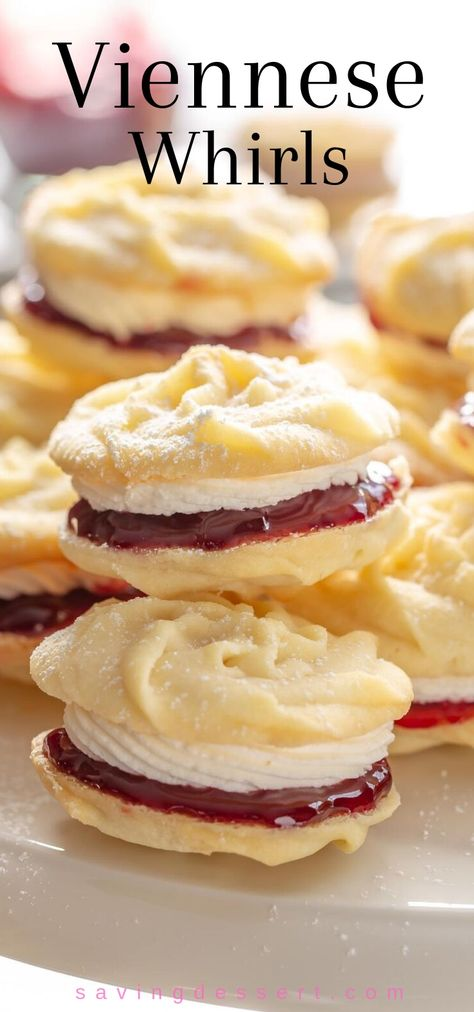 Mary Berry's Viennese Whirls - delicious, tender melt-in-your-mouth butter cookies with raspberry jam and vanilla buttercream filling. #Viennesewhirls #cookies #holidaybaking #raspberryjamcookies #buttercookies #Maryberry #whirls #christmascookies #christmasbaking #baking #cookierecipe #christmascookierecipes