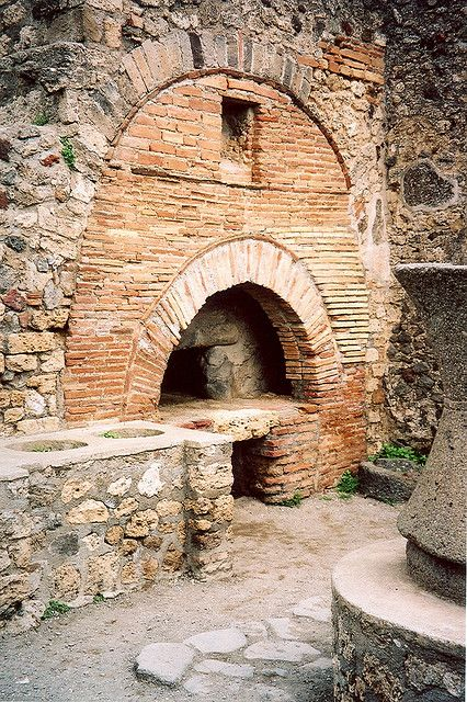A cooking hearth at Pompeii. One such oven was discovered to have bread inside when excavated.
