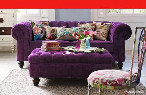 Purple Chesterfield Sofa and pretty, colourful cushions.