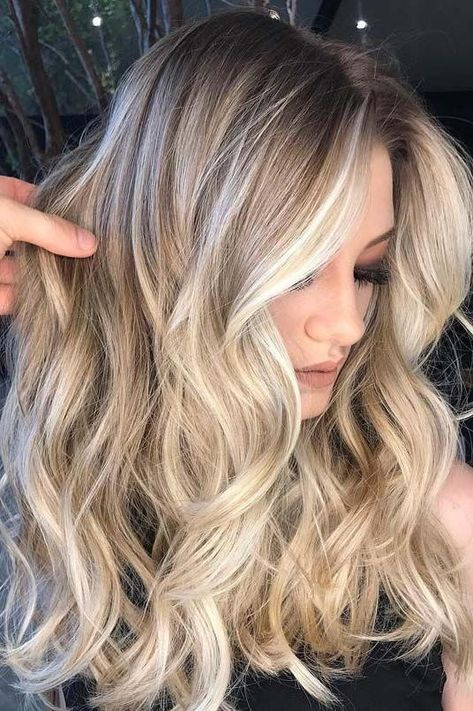 Cool Blonde with Shadow Roots | Sunkissed shades for your brightest summer ever. This season, hair colorists are picking up on hints that low-maintenance color is key. Between beach trips, far-flung adventures abroad and weekends spent honoring an ever-growing social calendar (hello, wedding season!), opportunities for touch-up sessions can come few and far between. Thankfully, you needn't play it safe on your hair color this season merely for the sake of time.
