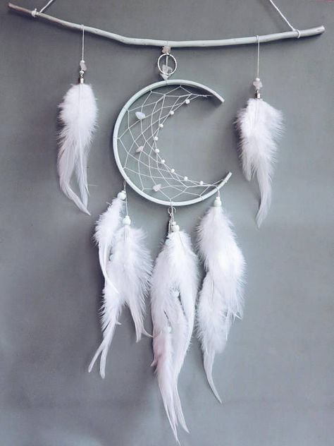 This unique awesome dream catcher will be a perfect addition to your rooms design. Mint crescent on willow twig - magic and cool design just for you. Oval (crescent) diameter - 5.1 inches (13 cm) Dreamcatchers height in total - 13.8 inches (35 cm) Twig length ~ 11 inches