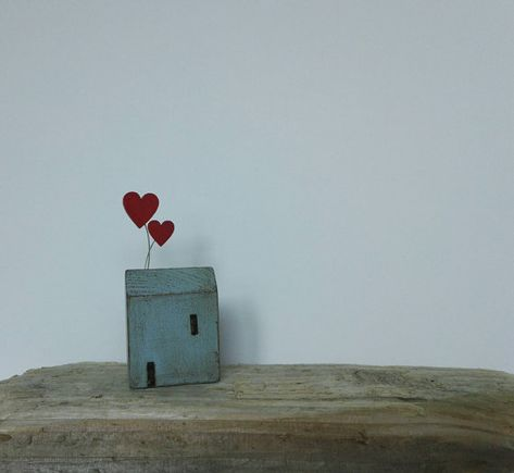 Little wooden house with love heart balloons. Folk art Cornish
