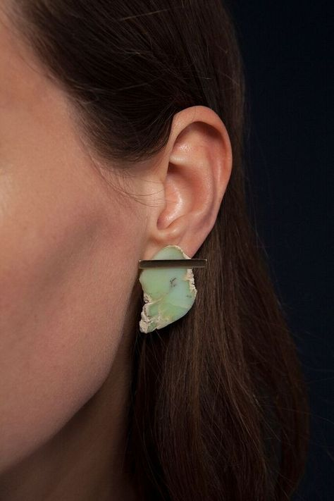 Jewelry designer and porcelain ceramicist Kathleen Whitaker's ubiquitous goldline and dot stud earringsare getting a colorful lift with a new collection that combines her signature fine, polished metal pieces with roughsemi-precious stones. The two elements are juxtaposed beautifully. Some of