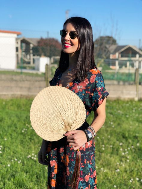 SUKI FAN | We love it as the perfect accessory to carry to a sunny day event. It also makes a beautiful piece to hang on your wall for a boho inspired decor.  Handmade is a beautiful palm leaf shape in palm straw, features an oversized silky pompon in colors inspired by the cherry blossoms. Shop the collection at cuckoob.com #japanesefashion #weddinginspiration #summerstyle #summerwedding