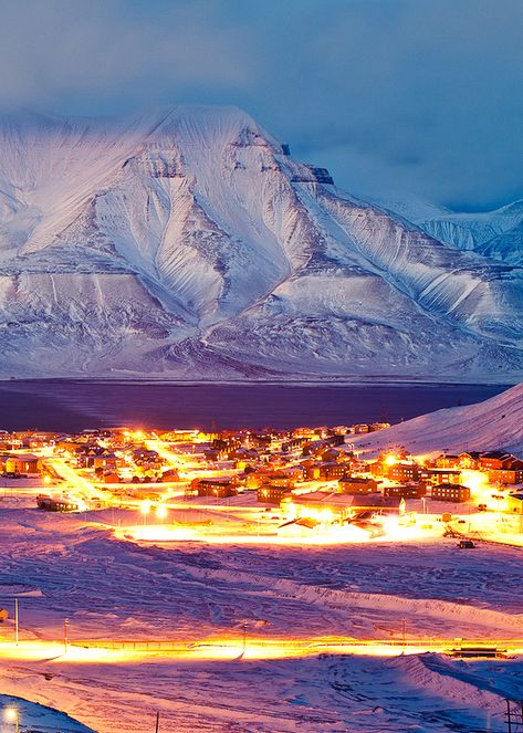 """Longyearbyen: """"Many visitors are surprised to find a normal town where they expected a pioneer city. This is no rough, tough 'Man's World', but a place for families. There are two kindergartens, a school and a small church built in 1958 to replace its war-damaged predecessor. Svalbard's lone functioning church belongs to the official Norwegian Lutheran Church and has a roomy hall and a vicarage."""" Svalbard: The Bradt Guide www.bradtguides.com"""