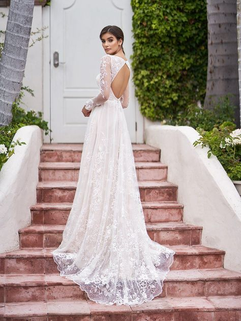 A romantic and ethereal style, style Surfside from Simply Val Stefani is effortlessly timeless. Soft lace and embroidered lace appliques run throughout this gown for an old-world charm detail just as the keyhole back adds a touch of sultry. Soft illusion sleeves trace along your arms, adding some romantic details to your gown. #alineweddingdress #bohoweddingdress #laceweddingdress #rusticweddingdress