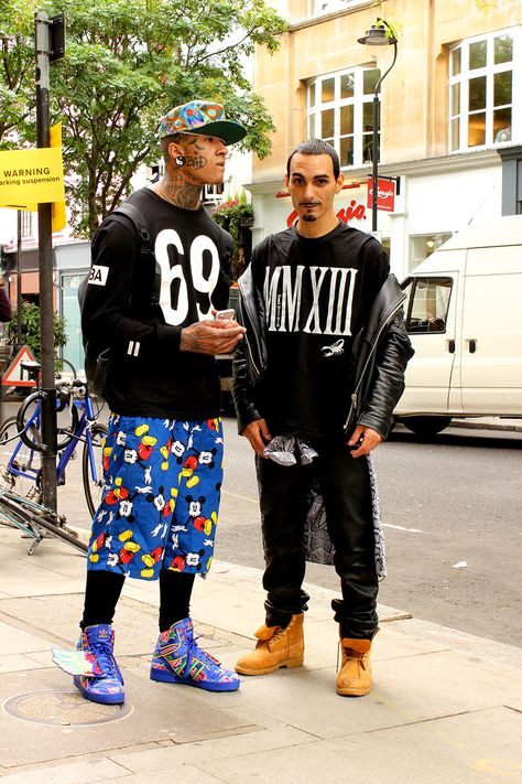 -London Men's Collections Day 2 Names: T.K and Kevin Amato Occupation: Musician/model (T.K) Photographer/casting director (Kevin) What are you wearing?: HBA Jumper, Adidas and Jeremy Scott Trainers (T.K) KTZ T-Shirt, Supreme Shirt, Marc Jacobs Trousers (K