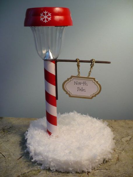 Dollar Store North Pole Street Light by Dollar Store Crafts - 30 Incredible Dollar Store DIY Christmas Decor Ideas. Easy to make decorations that you can do on a small budget. Make beautiful and easy centrepieces, ornaments, candle holders and mason jar crafts. These awesome Dollar Tree DIY Christmas crafts are simple enough to be made with your kids. Just click on this to find out more or pin for later!