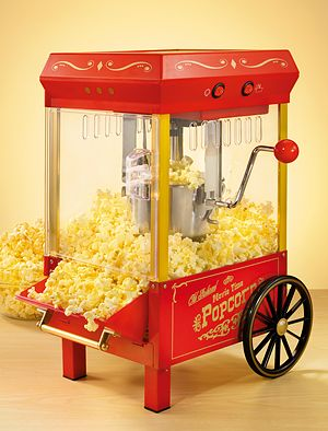 I SOO WANT THIS RIGHT NOW!!!  -This Old Fashioned Kettle Popcorn Maker is a convenient, tabletop-sized party pleaser.