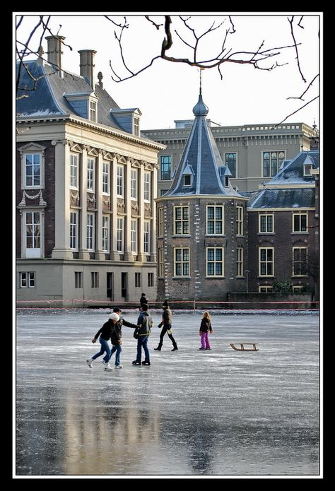 Ice skating at the pond in front of the governmental buildings- The Hague, Netherlands