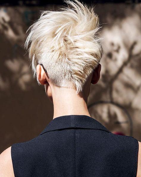 asymmetric blonde haircut style