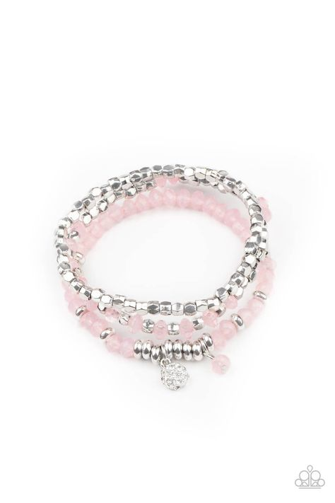 A glimmering collection of silver discs, silver cube beads, and opaque pink crystal-like beads are threaded along stretchy bands around the wrist, creating icy layers. A matching opaque crystal and white rhinestone encrusted charm swing from the display for a whimsical finish. Sold as one individual bracelet.