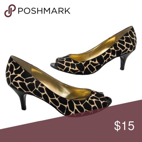 "Bandolino Black Tan Giraffe Animal Print Pump Spice up your closet with these Bandolino Black & Tan Giraffe Animal Print Pump. They feature an all over giraffe print in black and tan, peep hole toe and a comfortable 3"" heel that makes these perfect for every occasion. Excellent condition. All photos except the cover are of the actual item. Bandolino Shoes Heels"