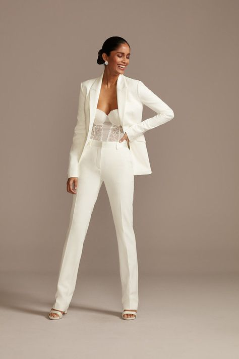 This modern satin wedding suit is one of our WeddingWire editors' top picks. WeddingWire has tons of recommendations for wedding dresses and jumpsuits for all wedding types. Click for more courthouse wedding dress ideas. Planning your wedding has never been so easy (or fun!)! WeddingWire has tons of wedding ideas, advice, wedding themes, inspiration, wedding photos and more. {David's Bridal} Prom Outfits, Classy Outfits, Stylish Outfits, White Wedding Suit, Wedding Suits For Women, Women In Suits, Elegantes Business Outfit, Wedding Pantsuit, Wedding Dresses