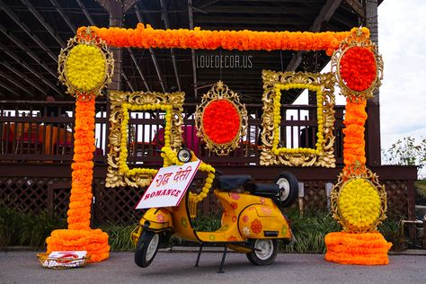 Marigold Sangeet decor, Sangeet, wisteria, Mehndi, Massachusetts, New Hampshire, Decorator, Backdrop, Mandap, Rhode Island, Connecticut, Moroccan theme wedding, Reception Backdrop, Indian Wedding, Wisteria, Candles, centerpieces, South Indian Wedding, Candle shelf, dramatic reception, candelabra Centerpieces, gold branches, orchids, Mehndi decor, Moroccan lantern centerpiece, Sangeet photo booth, Mehndi photo booth, scooter photo booth, marigold photo booth, sangeet decor