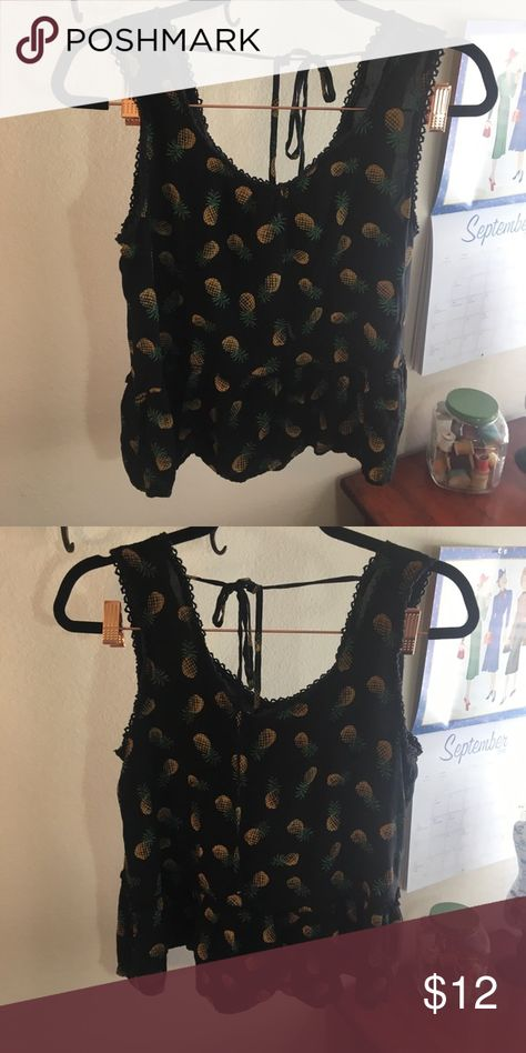 b4db57d4503bb8 Black peplum blouse with pineapples! 🍍. Size Large. Ties in the back
