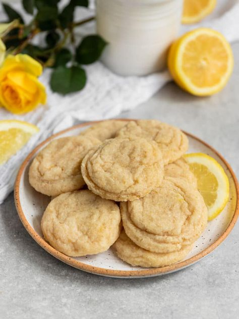 Truly the best easy Vegan Lemon Sugar Cookies! These soft & chewy lemon cookies made from scratch are so lemony and make the perfect simple sugar cookie recipe. Homemade vegan lemon cookies are amazing to serve at any party & make a great vegan cookie for Christmas, Easter, or Mothers Day! #lemoncookies #sgtoeats #vegancookies #lemonsugarcookies #veganlemoncookies #chewycookies #softcookies