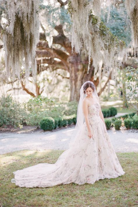 "From the editorial Watercolor Paintings, Garden Style Florals, and a Natural Palette Inspired This Kiawah River Wedding. The bride says, ""Charleston has such a special place in both our hearts as it is the place where we fell in love and both began our adult and professional lives. It was a no brainer to wed in the place we love most because it also happens to have some of the most beautiful locations to tie the knot."" 
