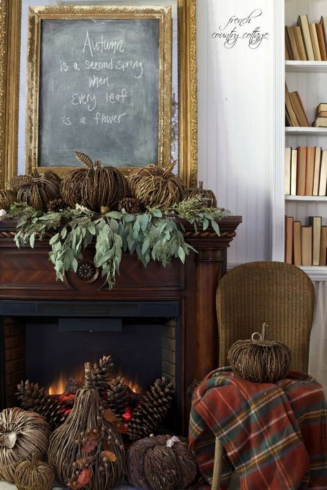 Simple natural fall decor with plaids, acorns, and pumpkins adoring a crackling fire. #frenchcountrycottage #falldecor #fallhomedecor