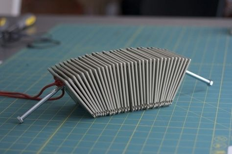 Use old floppy disks to make this cool-sounding percussive instrument. I 12 Sweet DIY Instruments For Cash-Strapped Musicians