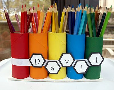 A simple craft that could be used for crayons to sort by color - just paint TP rolls then secure with a ribbon and add shapes with room names