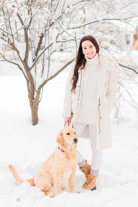 Looking for a cute golden retriever puppy or a casual way to wear 8 inch LL Bean boots in the winter? Click through for a chic all white winter outfit for women from affordable style blogger Stephanie Ziajka from Diary of a Debutante! She styles Bean boots with a white LL Bean long ultrawarm coat, white Express skinny jeans, a white oversized turtleneck sweater from Amazon Fashion, and beige thermal socks. #goldenretriever #puppy #llbean #fauxfurcoat #beanboots #winteroutfits #allwhiteoutfit