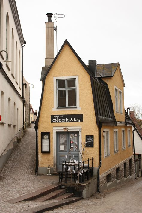 Baltic Sea / Gotland Island / City of Visby / Sweden - narrow cobbled streets and a cool looking wedge-shaped building. Oh The Places You'll Go, Places To Travel, Shop Fronts, Baltic Sea, Cafe Restaurant, Brothers Restaurant, Mellow Yellow, Stockholm, The Good Place
