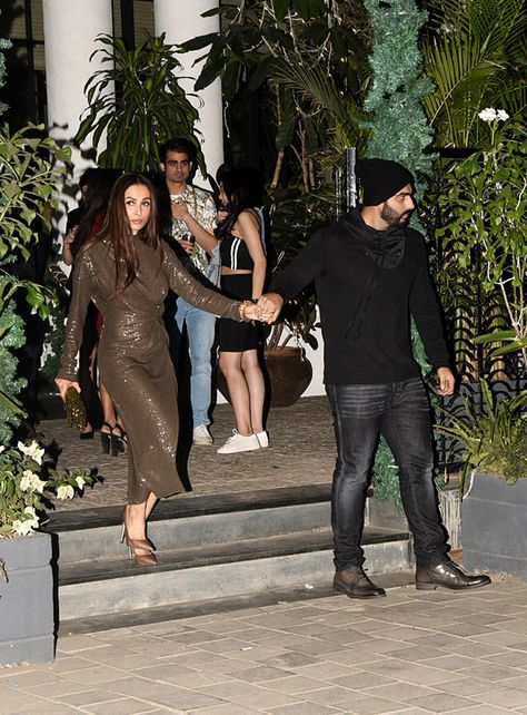 Malaika Arora spotted in a shimmer dress while Arjun Kapoor was in an all black attire.
