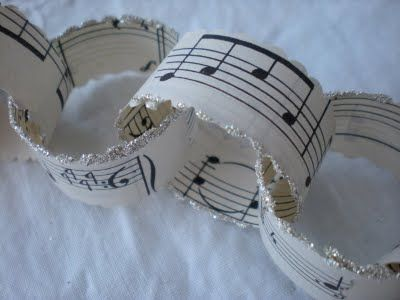 {oc cottage}: And On That Note...vintage music paper dipped in glitter makes a beautiful old fashioned paper chain. Easy peazy.