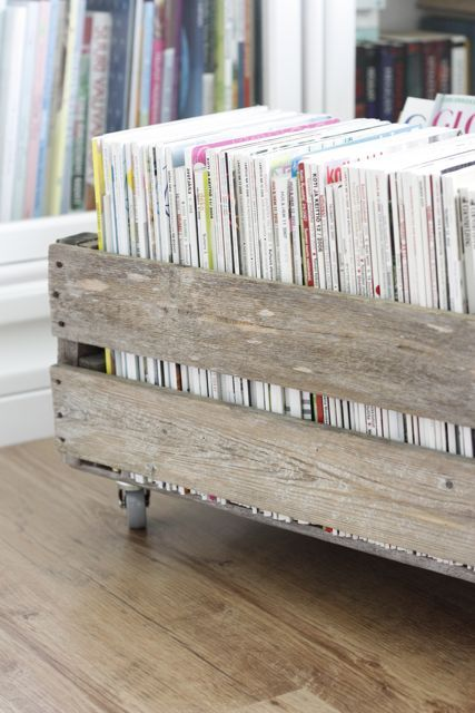 old wooden crate with casters for magazine storage