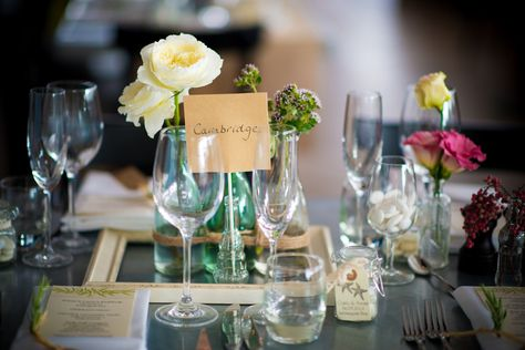 Table decorations at Annie & Carlo's wedding at Watergate Bay Hotel. Photography by Tyrone Mackenzie.