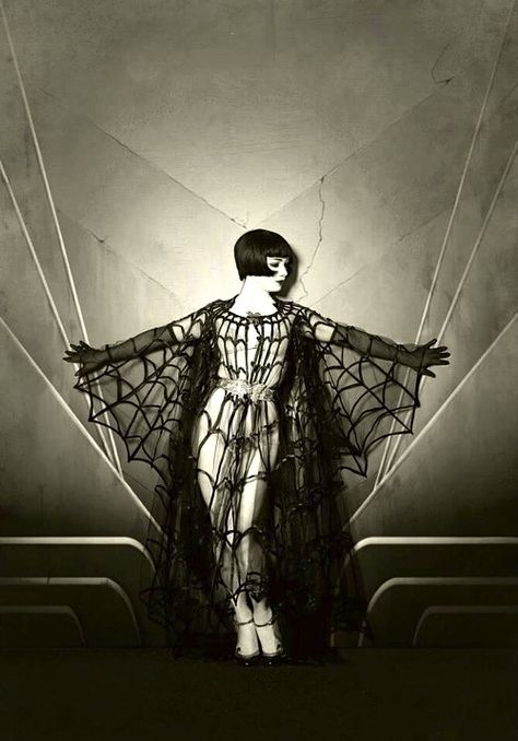 Burlesque Dancer in gothic sensual pose vintage style photo. She has the look of Louise Brooks
