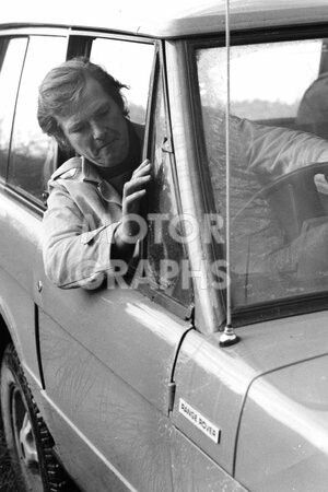 Roger Moore in 1971, driving a Range Rover on a visit to Solihull.