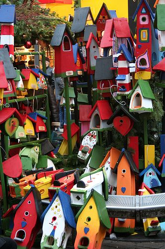 Bright colored birdhouses.