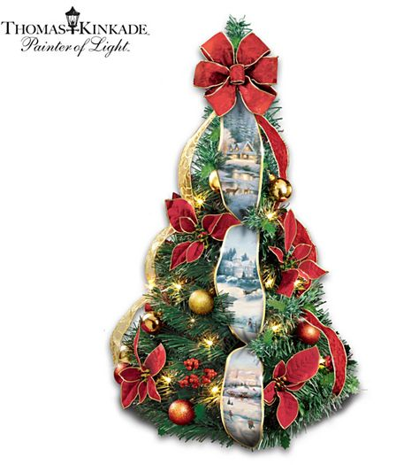 thomas kinkade merry miniature 2 ft pre lit pull up christmas tree takes just 3 seconds to assemble features six holiday scenes on cascading ribbons