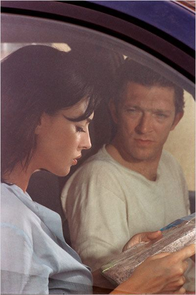 Monica Belluci reading a map in the film