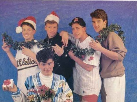 Only one New Kid (on the Block) was thoughtful enough to bring a gift. | 18 Extremely Awkward Celebrity Christmas Photoshoots