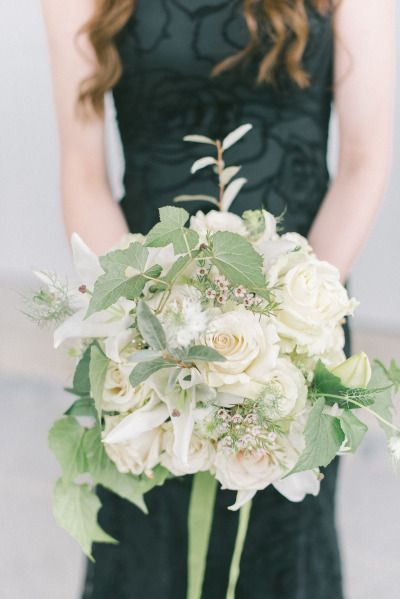 Elegant ivy additions to this white rose bouquet: http://www.stylemepretty.com/maryland-weddings/2015/02/10/elegant-maryland-wedding-at-historic-oakland/ | Photography: Elizabeth Fogarty - http://elizabethfogartyphotography.com/