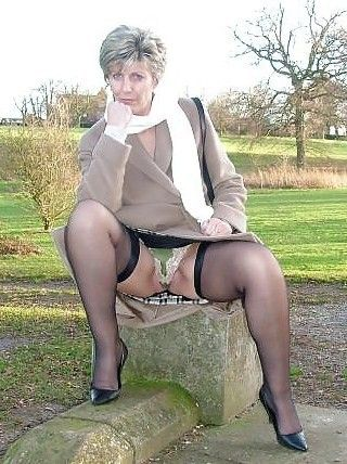 Upskirt mature woman