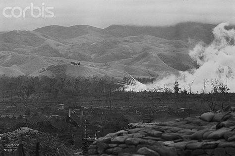 01 Mar 1968, Khe Sanh, South Vietnam --- Scratch One Gun.  Khe Sanh, South Vietnam:  A Skyraider (left) drops a bomb on a perimeter of the base at Khe Sanh in an effort to knock out a newly installed Communist artillery piece.  The gun was able to fire only two rounds before it was eliminated.  Photographer:  Dave Powell. --- Image by © Bettmann/CORBIS