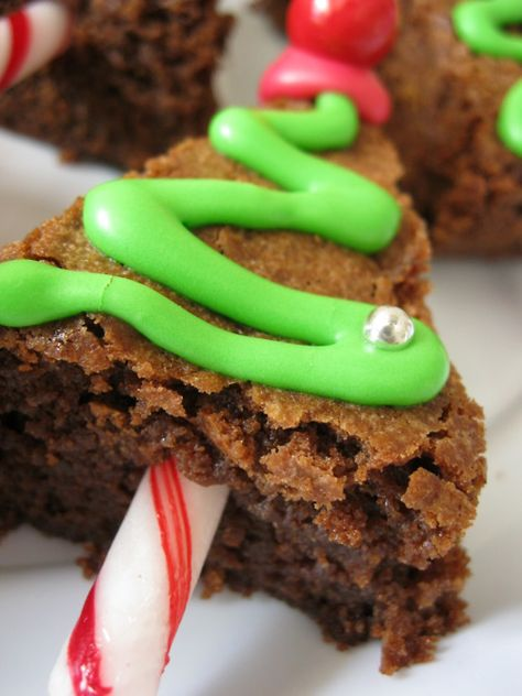 Brownie cut into a triangle, icing and a peppermint stick is all you need to make this fun festive treat!