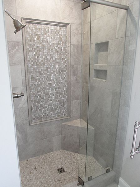 Tiled Shower w/ Corner Bench, Combo Niche, and Accent Frame featuring Lunada Bay Tile's Marbleized Wings Straight Set in Burlywood Silk. Tile and Installation by Exact Tile Inc #bathroom #shower #tile #lunadabaytile #exacttile #knoxville #tennessee #shoplocal