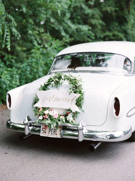"""Just Married"" wreath adorned getaway car: http://www.stylemepretty.com/2015/12/28/classic-garden-wedding/   Photography: Lauren Balingit - http://laurenbalingit.com/"