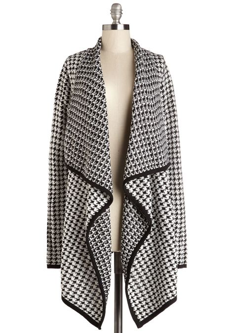 When you need some good old-fashioned snuggling, get the TLC you seek in the time-honored pattern of this black and white cardigan.
