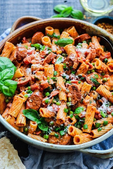Vodka Rigatoni with Smoked Sausage and Peas - full of mouthwatering flavor, budget-friendly and uses ingredients most likely already in your pantry and fridge! #vodkarigatoni #easyvodkarigatoni #pastadinner #pastadishes #italianrecipes #mealprep #budgetmeals #pantryrecipes #giveitsomethyme   giveitsomethyme.com